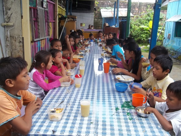 Peru orphans eating lunch
