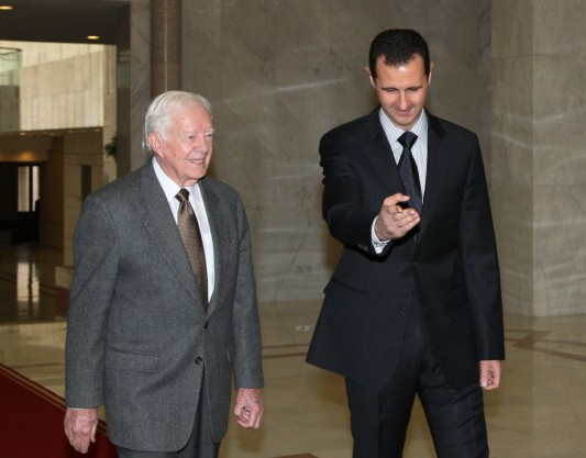 syrias-president-bashar-al-assad-welcomes-former-u-s-president-jimmy-carter-before-meeting.jpg