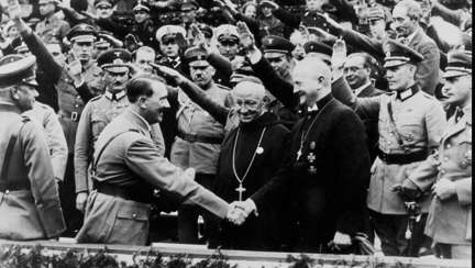 bishop-ludwig-muller-leader-of-the-reich-church-in-germany-greets-adolf-hitler-during-world-war-ii.jpg